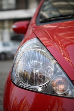 shiny car: reflector of a shiny red car