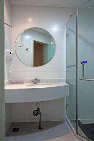 a modern, contemporary designer bathroom photo