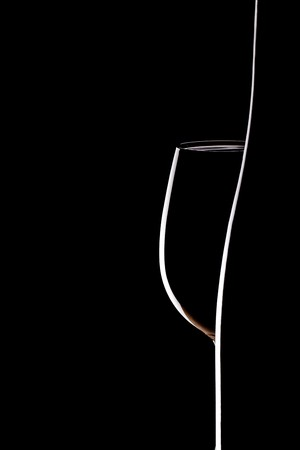empty glass and winebottle on black background