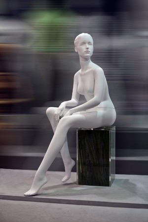 Mannequin in front for the blur background , no clothes, Dummy. photo