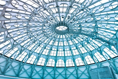 A glass structure supporting the roof of a building photo