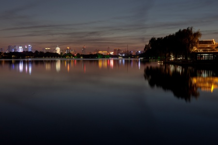city skyline by night. lake photo