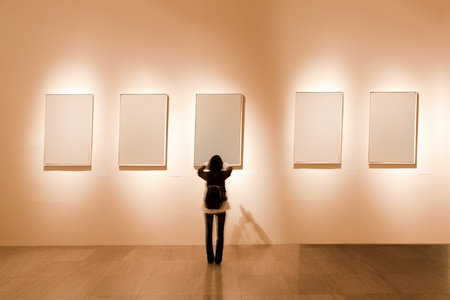 shanghai art gallery, girl look at the blank frame photo