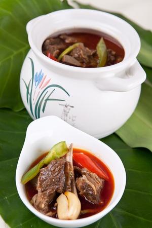 chicken meat: chicken meat soup in a earthen jar