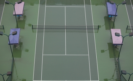 tennis stadium: The tennis court is very empty after rain Stock Photo