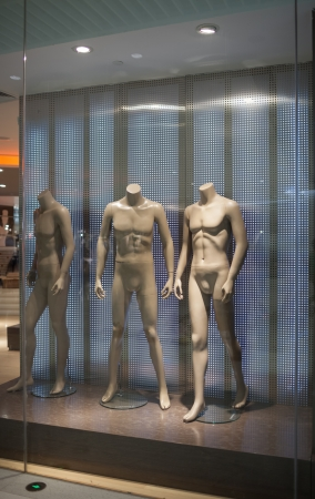 mannequin in showcase, no clothes, dummy. photo
