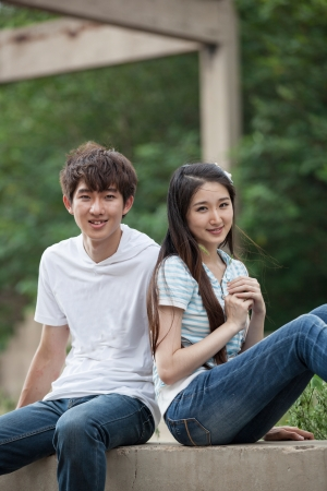 a young Asian couple is playing outdoor photo