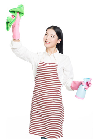 beautiful cleaning girl standing in isolated on white background. asian chinese woman. photo