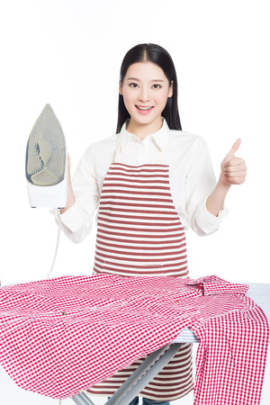 young housewife ironing isolated on white background photo
