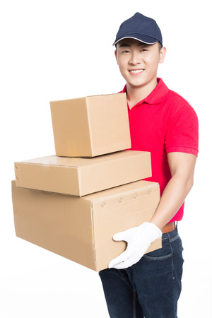 delivery man carrying cardboard box, white background.