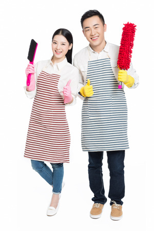 couple hold cleaning tool on white background photo