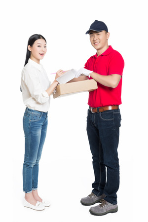 young courier deliver package to pretty woman, white background. Stock Photo