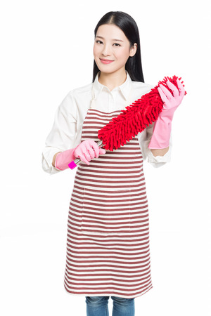 sweep: picture of beautiful woman with cleaning sweep, white background Stock Photo