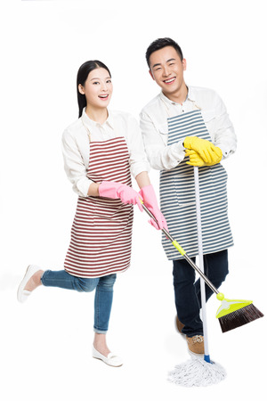couple hold cleaning tool on white background