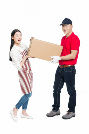 young courier deliver package to pretty woman, white background. Standard-Bild