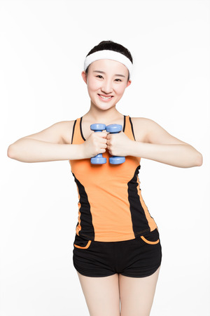 girl working out: chinese girl working out with dumbbells