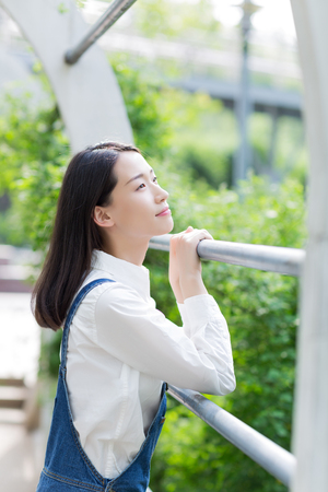 chinese adult: girl looking at the sky Stock Photo