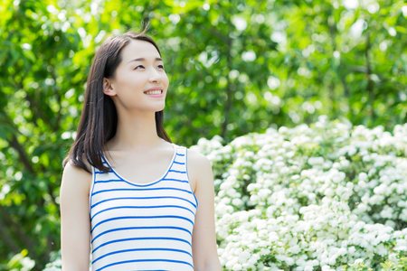 chinese adult: smiling happy girl in the park, asian woman