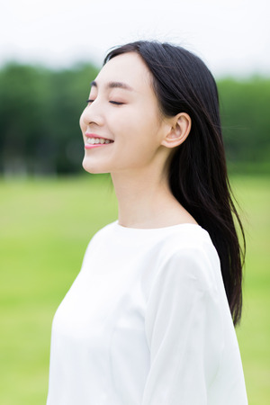 smile face: girl with white dress in the park
