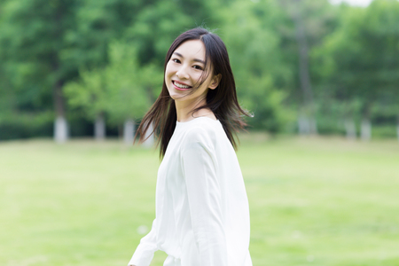 asian woman with white dress in the park