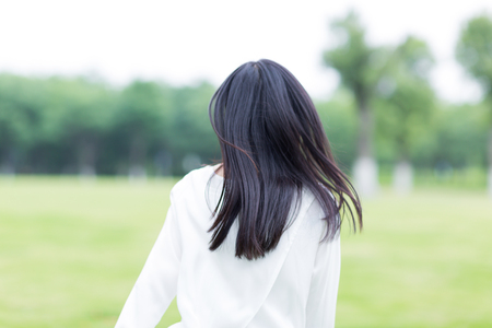 view woman: woman in nature, back view Stock Photo