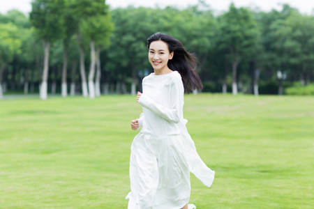 asian natural: chinese girl running in the park Stock Photo