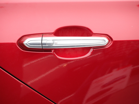 argent: red and silver limousine door handle
