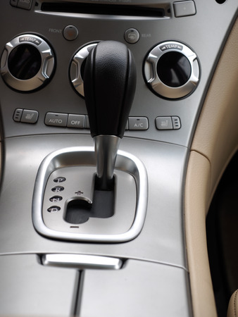 gearshift: luxury car interior, automatic gearshift and air conditioner knobs