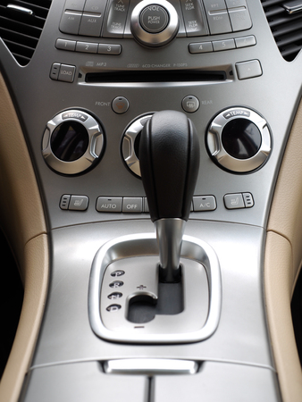 gearshift: luxury car interior, automatic gearshift and  air conditioner knobs Editorial