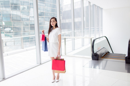 trading floor: chinese girl with her shopping bags