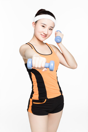 girl working out: beautiful chinese girl working out with dumbbells over white background