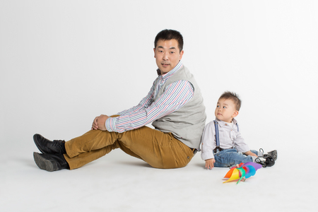 back ground: Portrait of a father and son Stock Photo