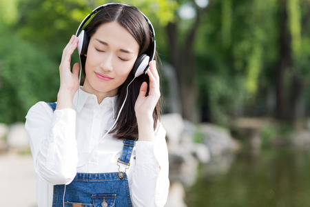 asian lady: chinese girl enjoying her music
