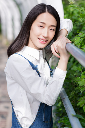 chinese adult: chinese girl with white top, blue jeans