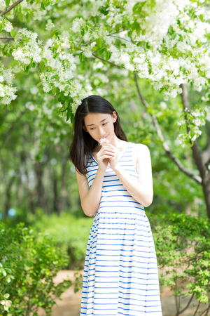 chinese adult: chinese girl enjoying the nature at outdoor Stock Photo