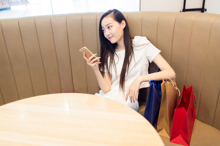 girls youth: chinese girl sitting alone in a coffee shop Stock Photo