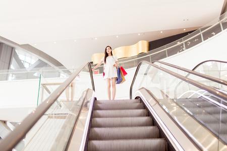 trading floor: stylish chinese girl holding shopping bags
