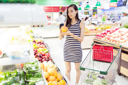 shopping cart: chinese girl in the supermarket