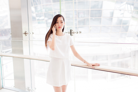 asia people: chinese girl wearing a white dress Stock Photo
