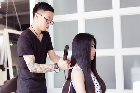 in beauty salons clubs and professional hair stylist to the girl in hair design photo - Professional Hair Stylist