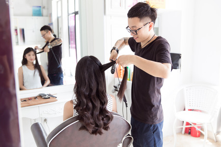 perm: in beauty salons clubs, and professional hair stylist to the girl in hair design Stock Photo