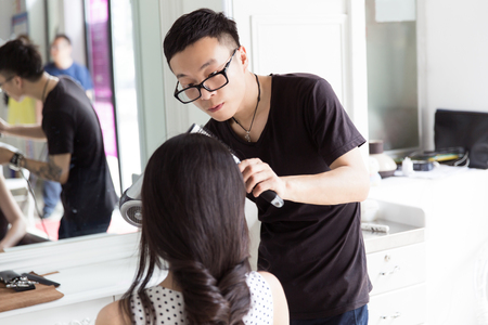 hair stylist: in beauty salons clubs, and professional hair stylist to the girl in hair design Stock Photo