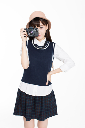 pinched: pretty girl, holding hands SLR camera, she is a photography enthusiast. Stock Photo
