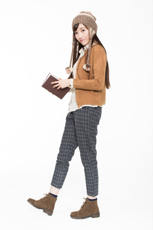 pretty cute girl holding books, standing in the classroom to read. Students, high school students Zdjęcie Seryjne