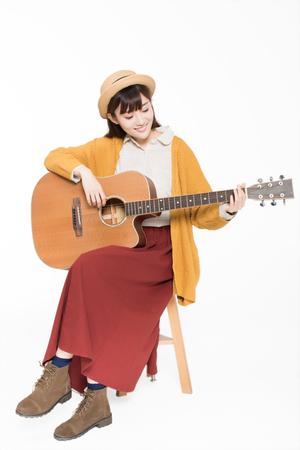 beautiful beautiful musician, holding a guitar, playing wonderful music