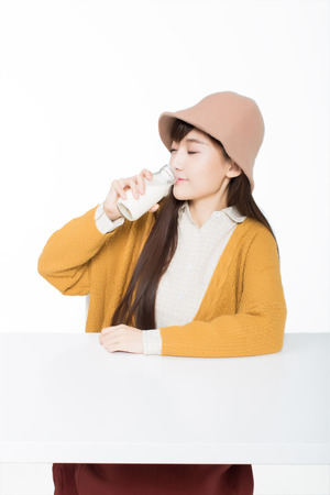 girl sitting in a classroom with drinking the bottle of milk Reklamní fotografie