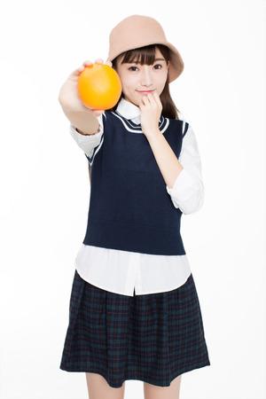 오렌지를 들고 예쁜 중국 소녀 스톡 콘텐츠