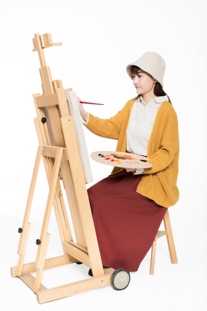 coatings: chinese painter beautiful girl, sitting in front Sketchpad, holding painting palette