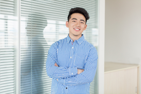 chinese young and handsome young man, wearing a blue shirt Stock Photo