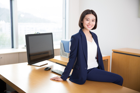 black lady: young beautiful girl, sitting in the office began her work